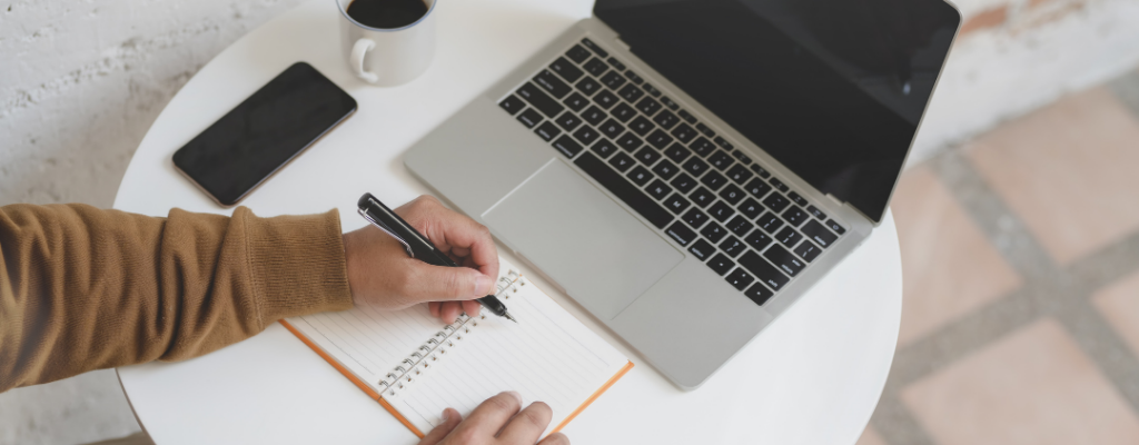 computer and writing pad